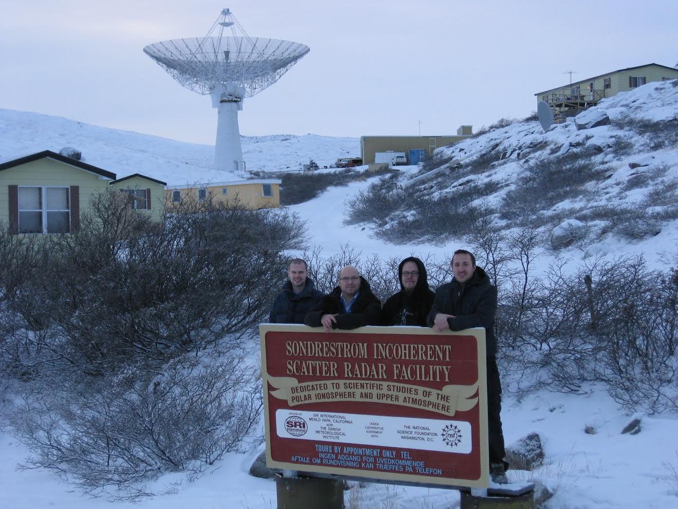 Sondrestrom staff standing before Sondrestrom radar dish in background.