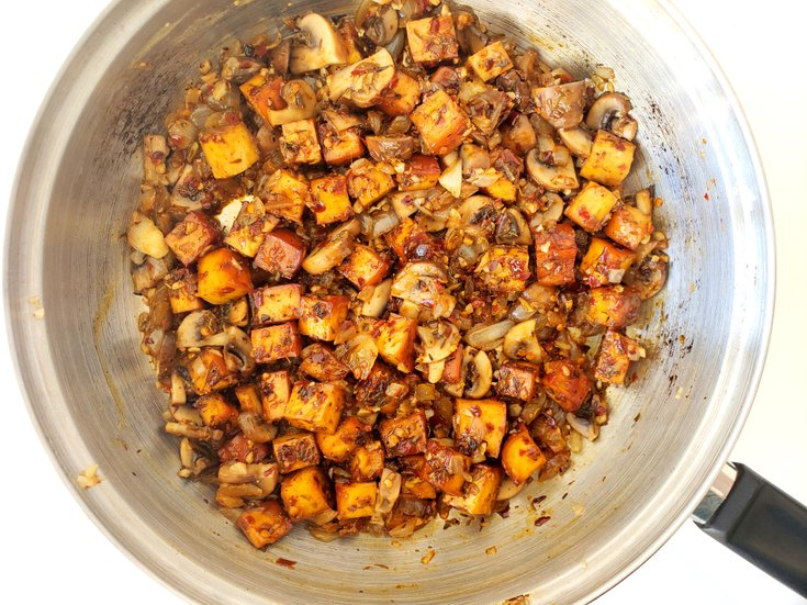 Pan with Jerk Tofu, Onions, and Portobello Mushrooms