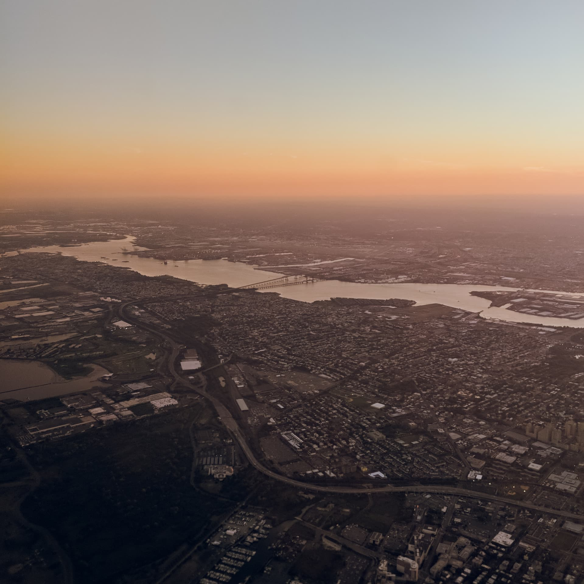 Looking west across Jersey City at dusk from the air. The image has a distinct Blade Runner-esque feeling to it.