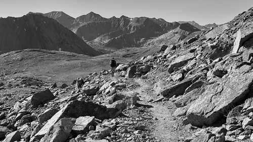 A hiker descends from Pinchot Pass