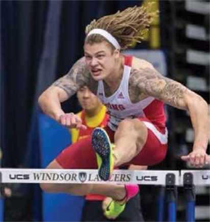 Kayden Johnson jumping hurdles at the Knights of Columbus games.