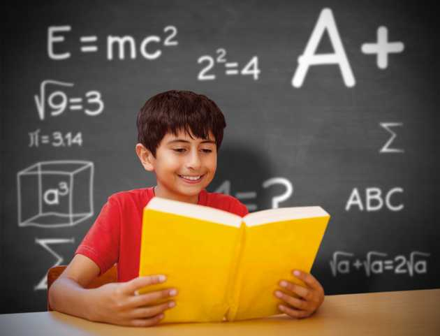 Child reading textbook in front of blackboard with math equations