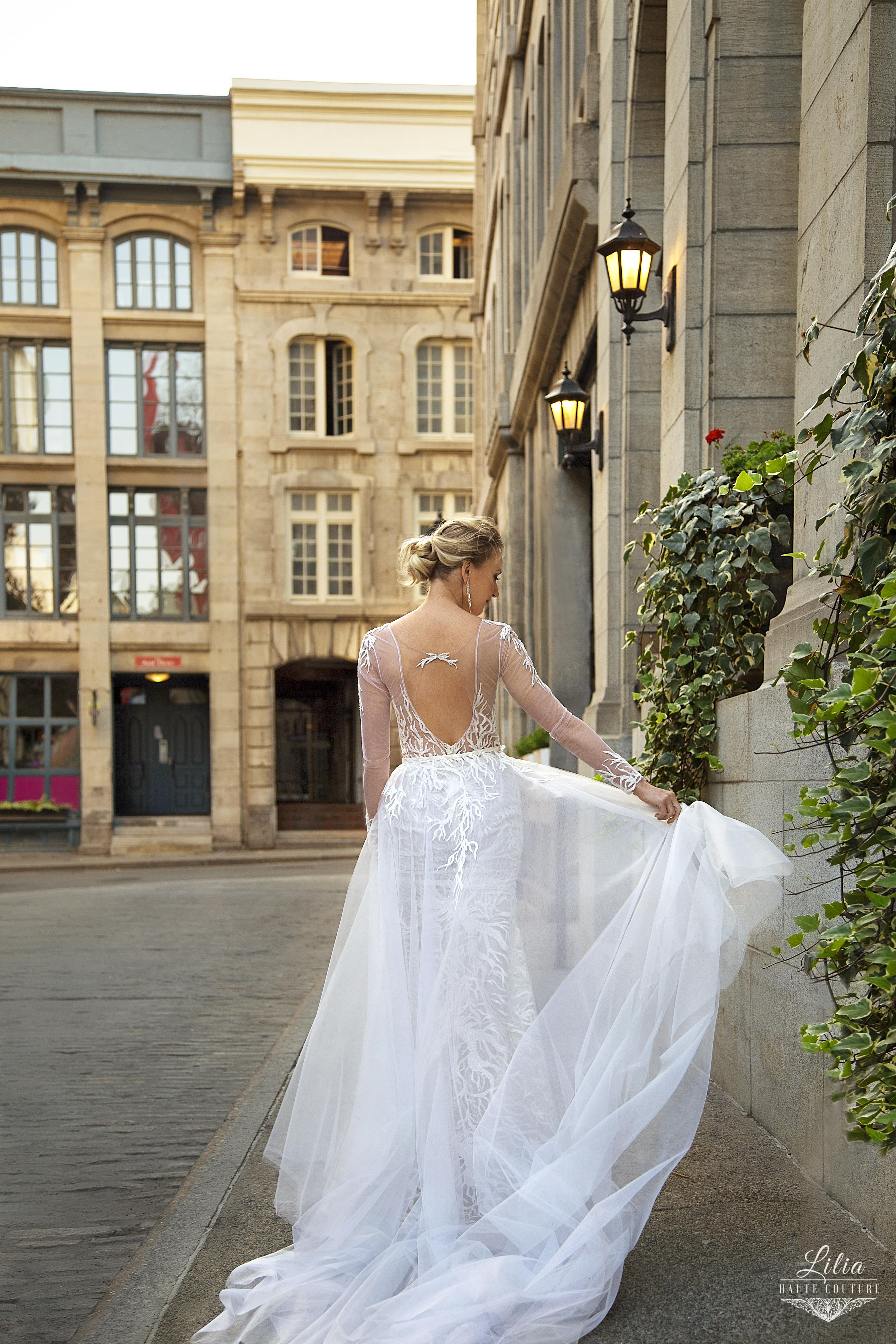 modern long sleve open back wedding dress lilia haute couture