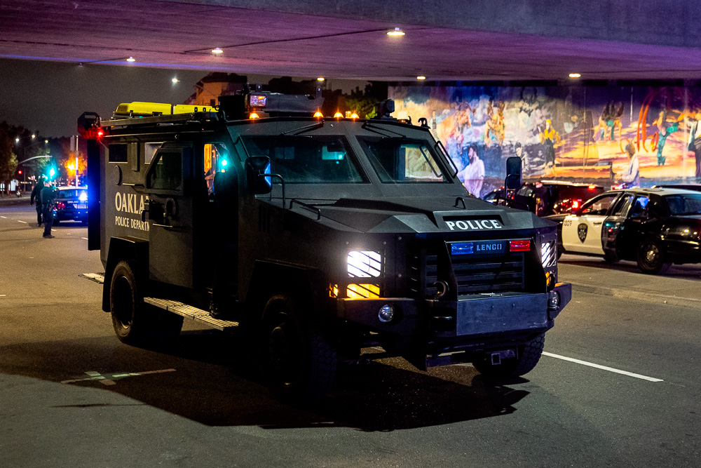 An Oakland Police Department BearCat — an armored personnel carrier often used by militaries and police forces — sits on Grand Avenue in Oakland, Calif., August 26, 2020.