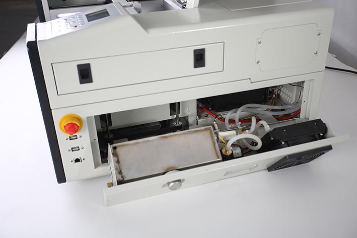 right panel opened, on the Aeon Mira CO2 Desktop Laser Cutting Machine