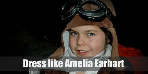 """All you need for your Amelia Earhart costume is some aviator gear such a goggles, a bomber jacket, tall leather boots, and khaki pants."""