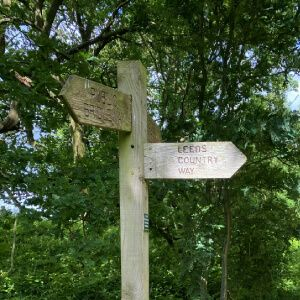 Wooden sign at Meanwood Park directing to Meanwood Valley trail