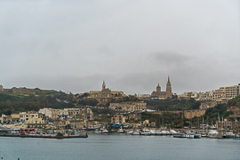 The village of Mġarr, as seen from the inbound ferry.  ferry from Cirkewwa to Gozo, near Mġarr, Malta, 2019