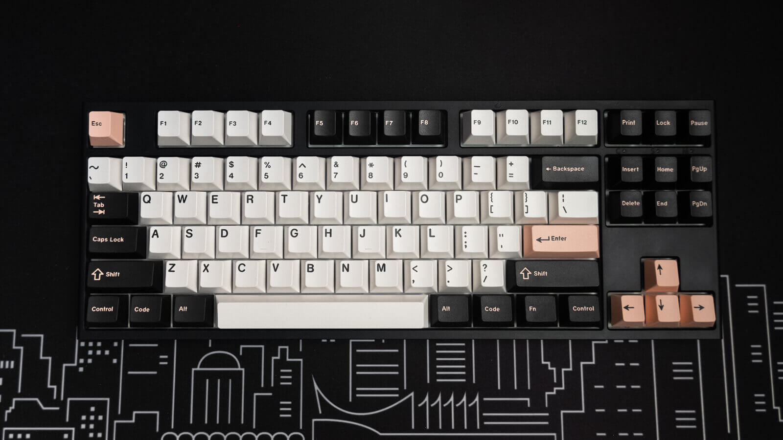 A regular keyboard with white, black, and pink keycaps.