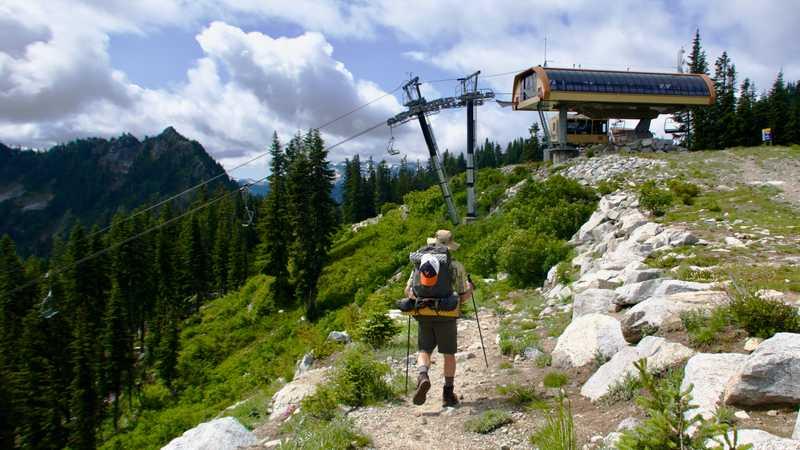 Ralph walks past a Stevens Pass ski lift