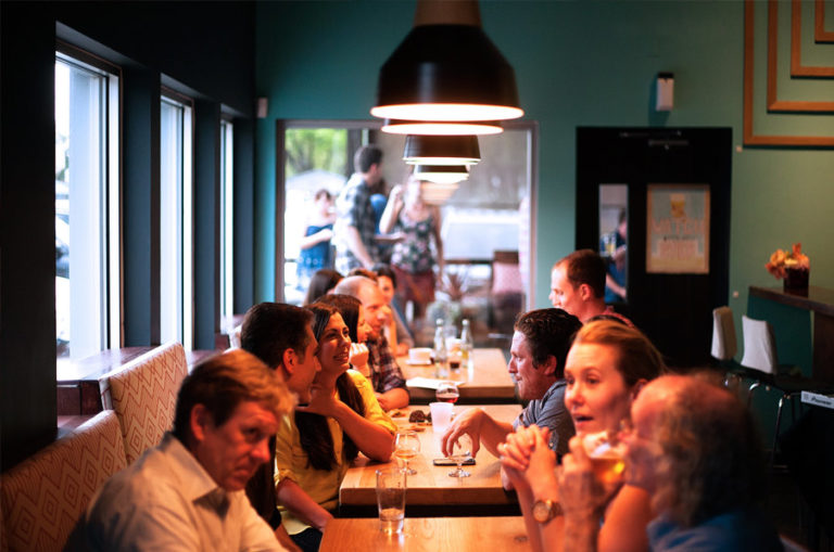 a party of people sitting at a restaurant