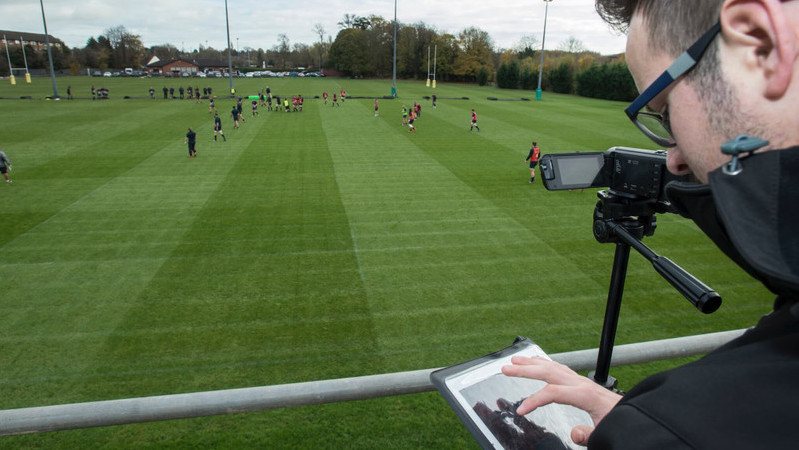 Performance analyst Simon Barbour assesses gameplay from the sidelines