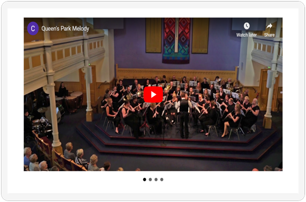 The video slider section of the Aberdeen Concert Band Media Page showcased on a screen