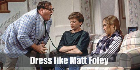 Matt Foley usually wears a light blue blazer, a green tie, and khaki pants