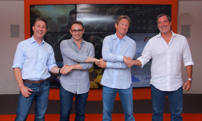 Photo of 4 men shaking hands