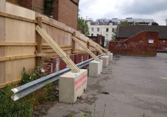 free-standing timber hoarding with supports