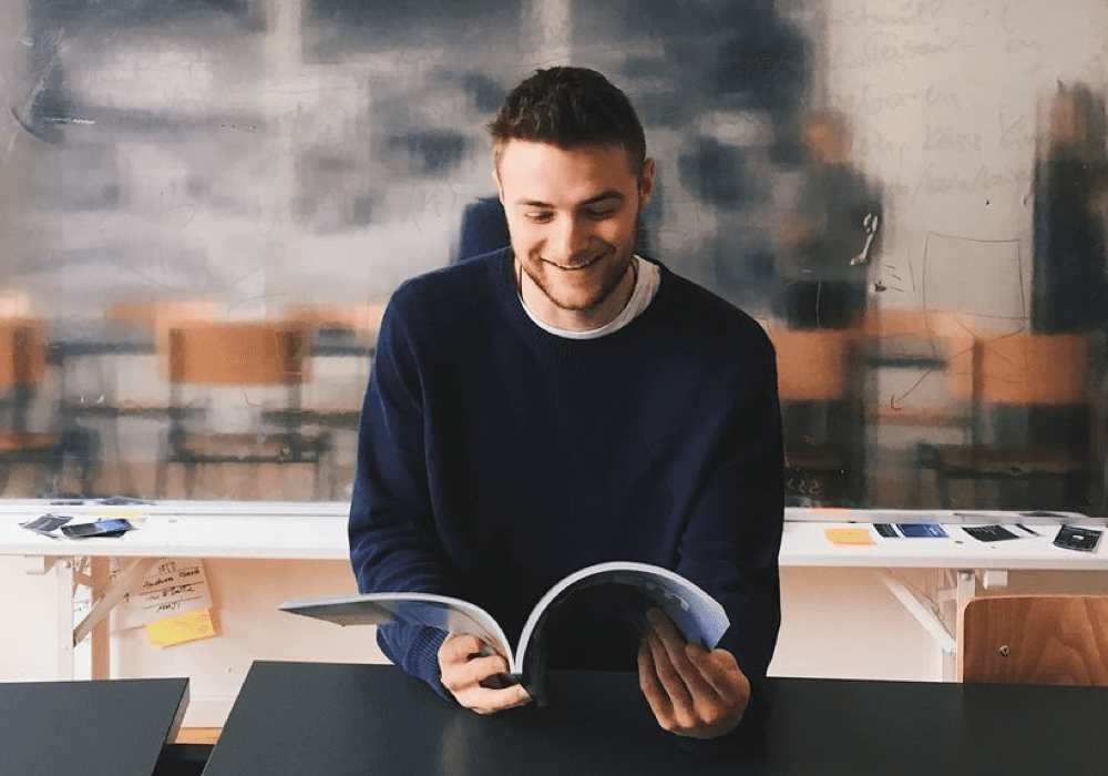 Employer browsing a brochure while smiling