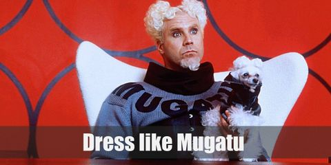 Mugatu wears a gray sweater with black details and his name in bold letters across his chest. He also has on a pair of black pants and black shoes.