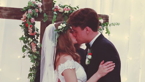 Ben and Amelia wedding ceremony kiss