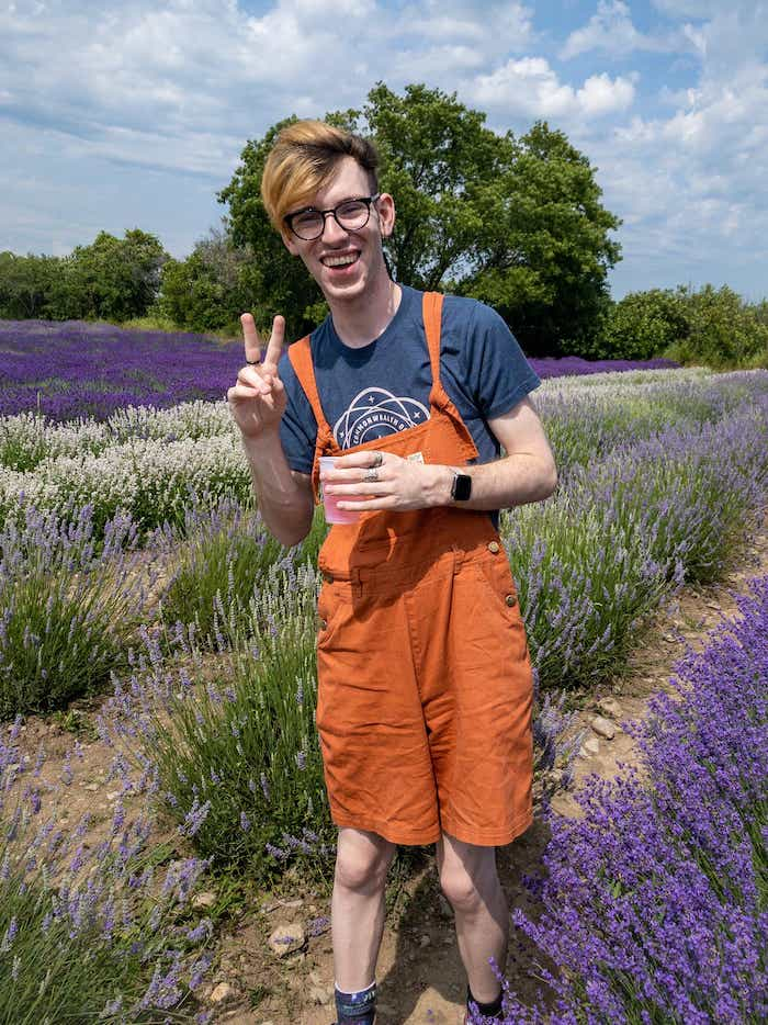 Quinn Pollock standing in a lavender patch
