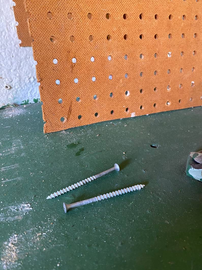 Screws that held up the pegboard