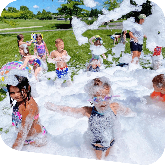 Children playing in a pile of foam.