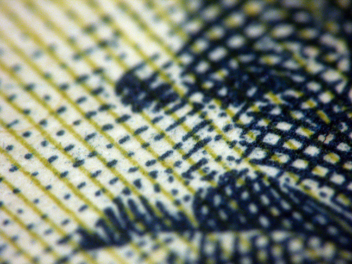 close up of crosshatching on currency