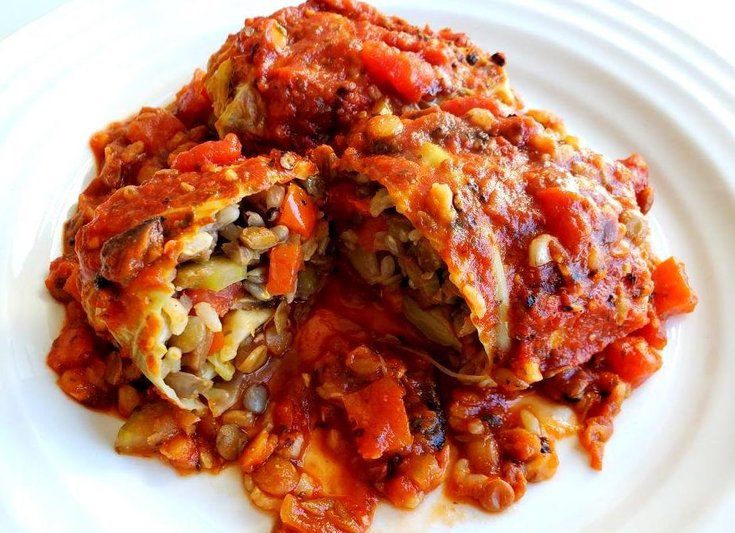 Plate with cabbage roll stuffed with lentils and rice