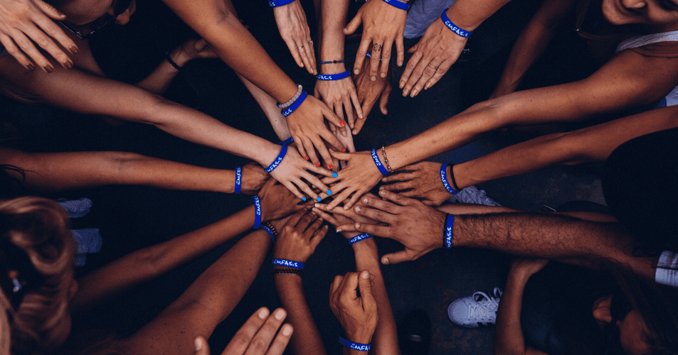 Group hands in huddle