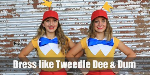 Tweedle Dee and Tweedle Dum are so eerily similar that they also wear identical, brightly colored clothes. They both have on bright yellow shirts with white collars and a light blue bow tie. They also pair it with bright red pants and a bright red cap with yellow propellers.
