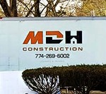 The MDH Construction truck servicing a home improvement project in Plymouth, Massachusetts