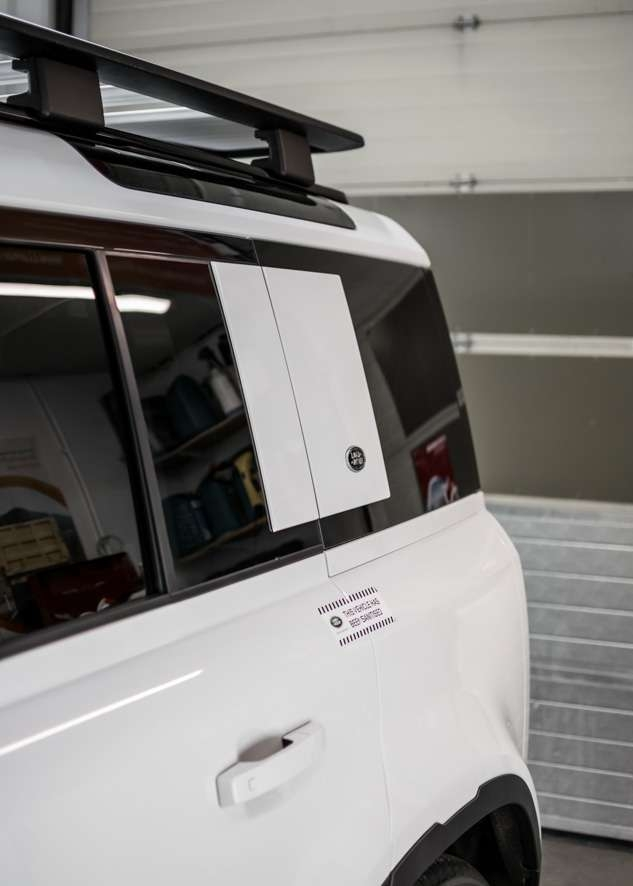 White Land Rover Defender rear tinted windows after window tinting