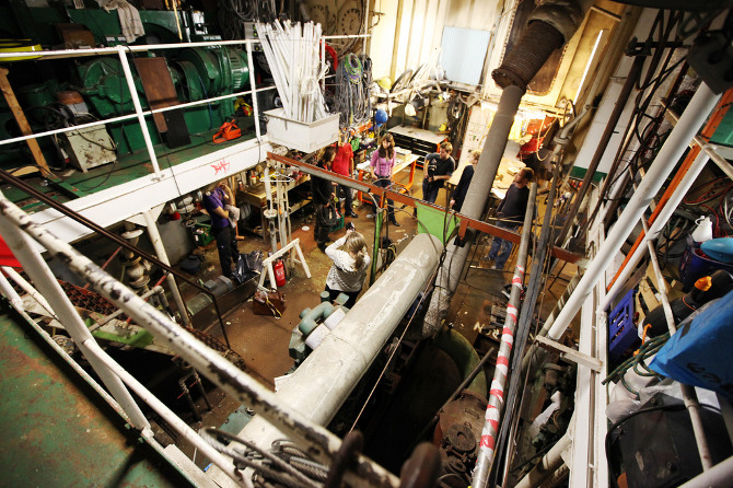 a two-story lab and design studio space held in a barge -- the practice of illutron collective in Denmark