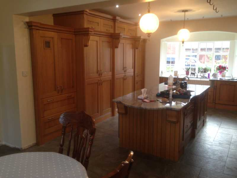 New oak kitchen with central island and food storage