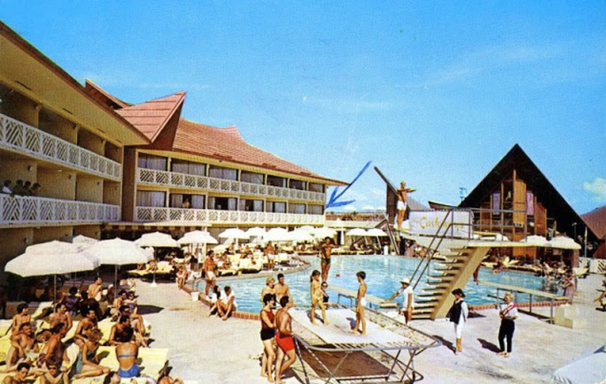 vintage postcard depicting the swimming pool of the castaways resort motel in miami beach, florida
