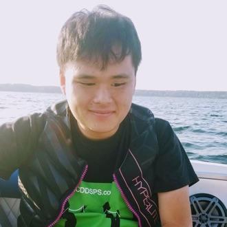 Harrison Tu in boat on water