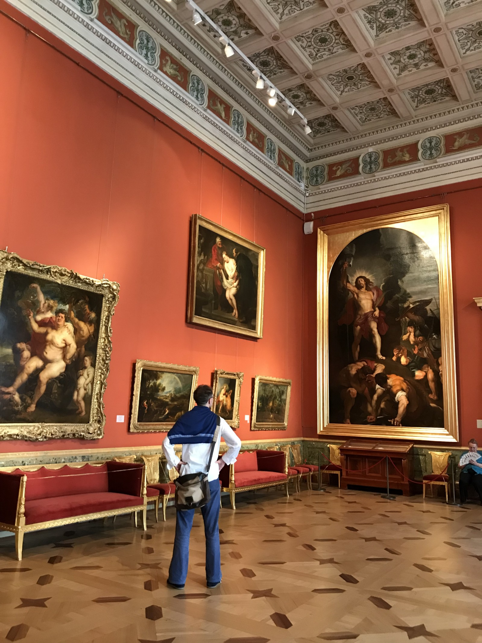 Andrey admires the artwork of Rubens inside The Hermitage Museum.