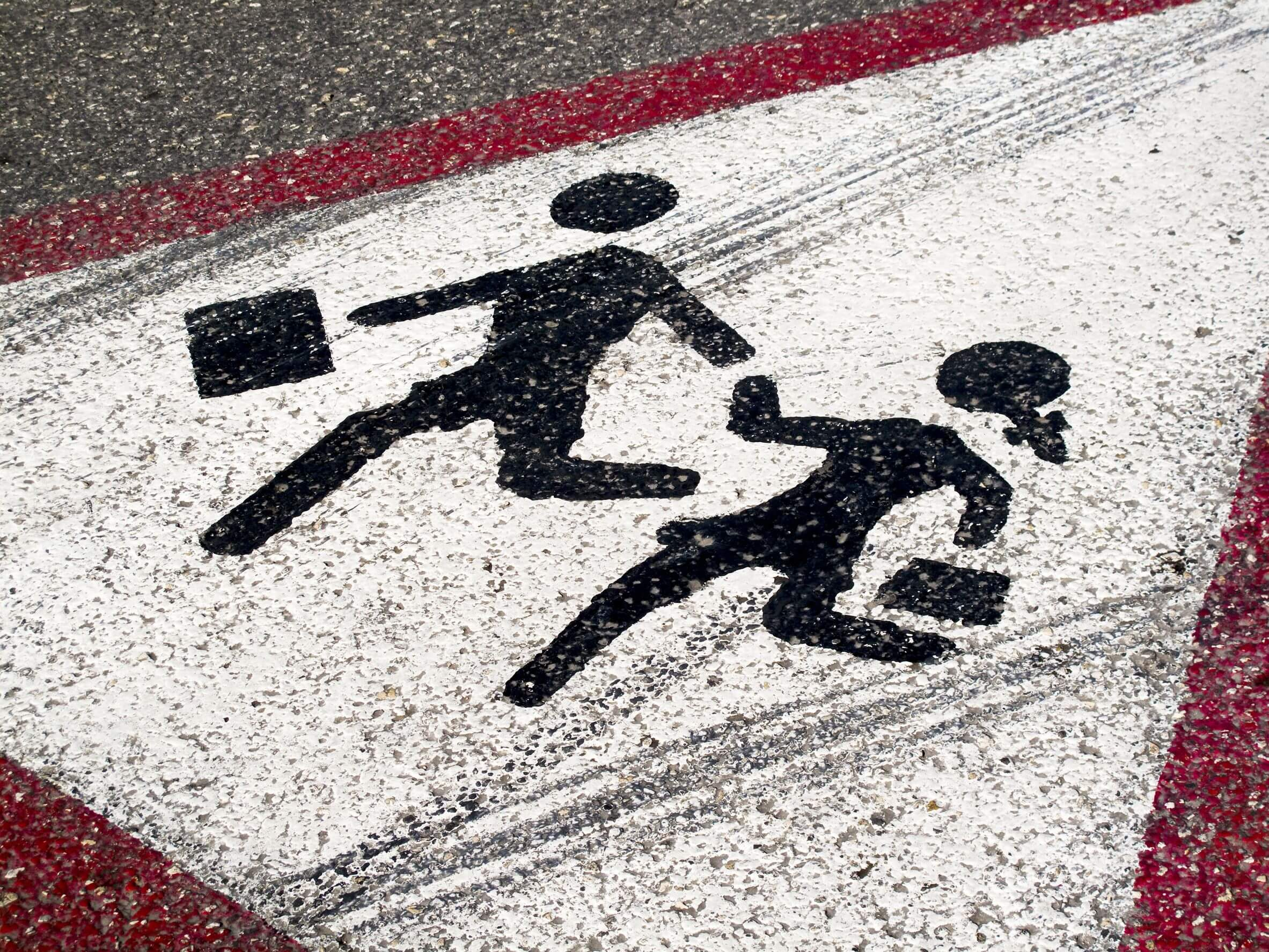 children crossing sign on pavement