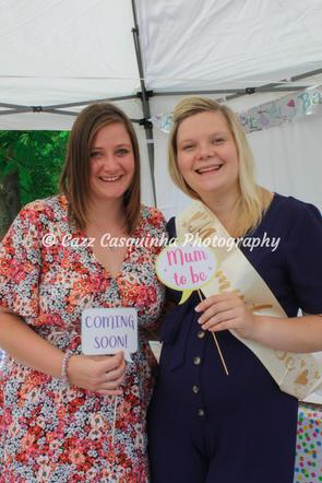 Mummy-to-Be and her friend holding baby shower photo booth props