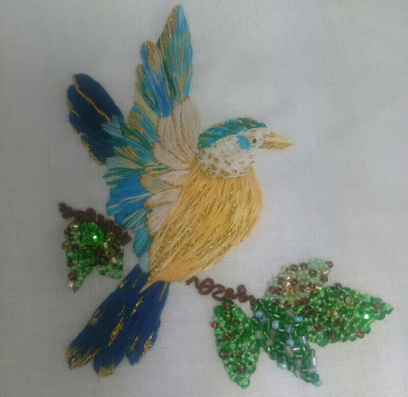 A silk shading kingfisher with beads