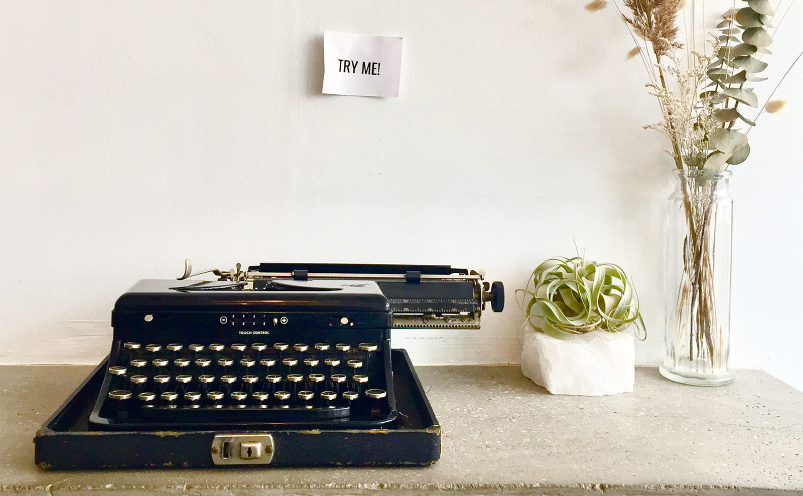 vintage typewriter on a table with flowers