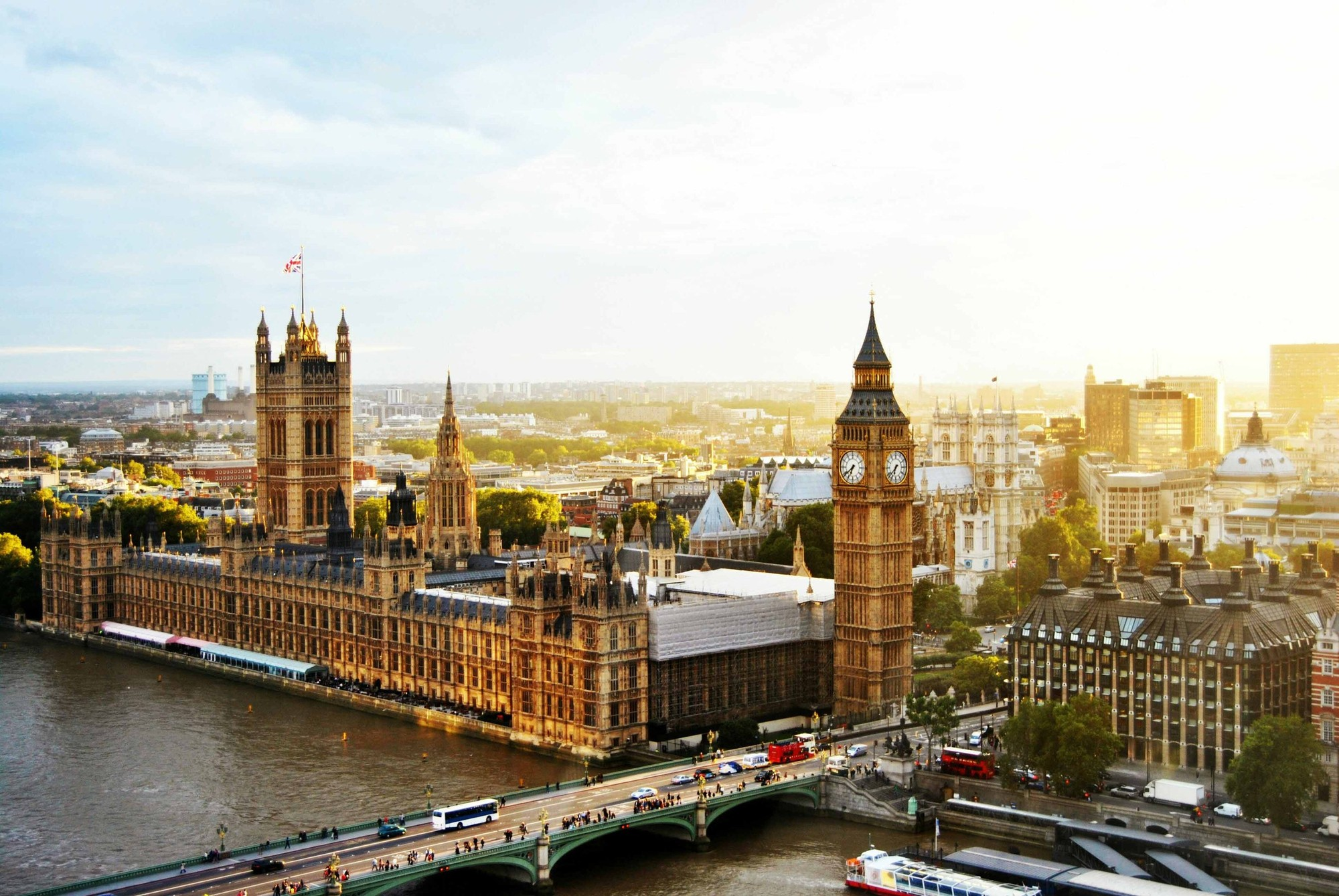 The Palace of Westminster rises above the River Thames with the London skyline in the background
