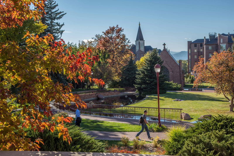 University of Denver students walking across campus on a sunny fall day