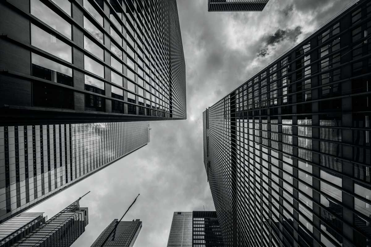 view of tall skyscrapers while looking up from the ground