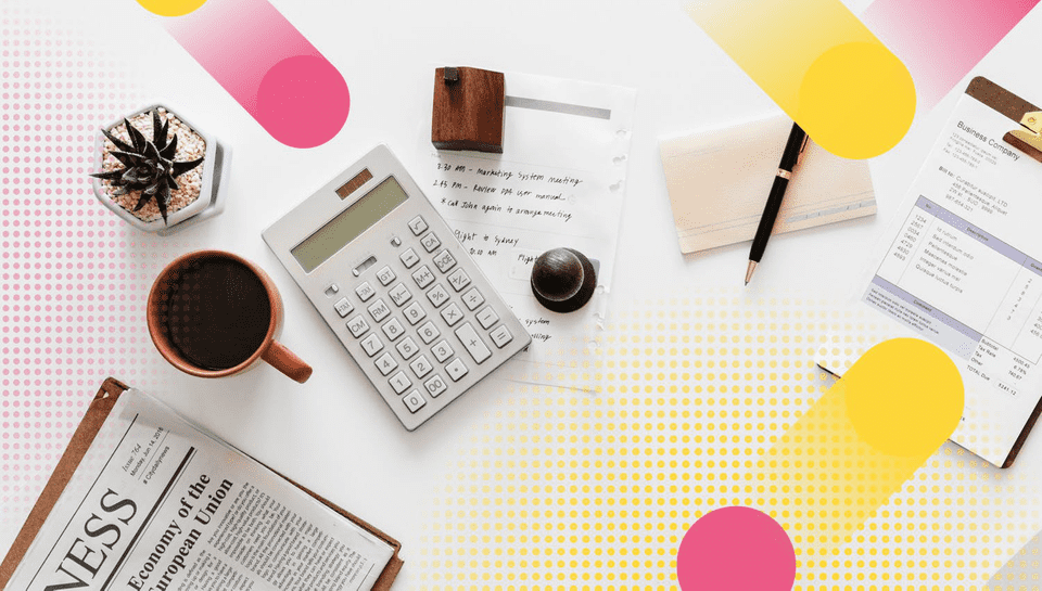 A flat lay including a newspaper, a coffee cup, a plant, a calculator, and a pen