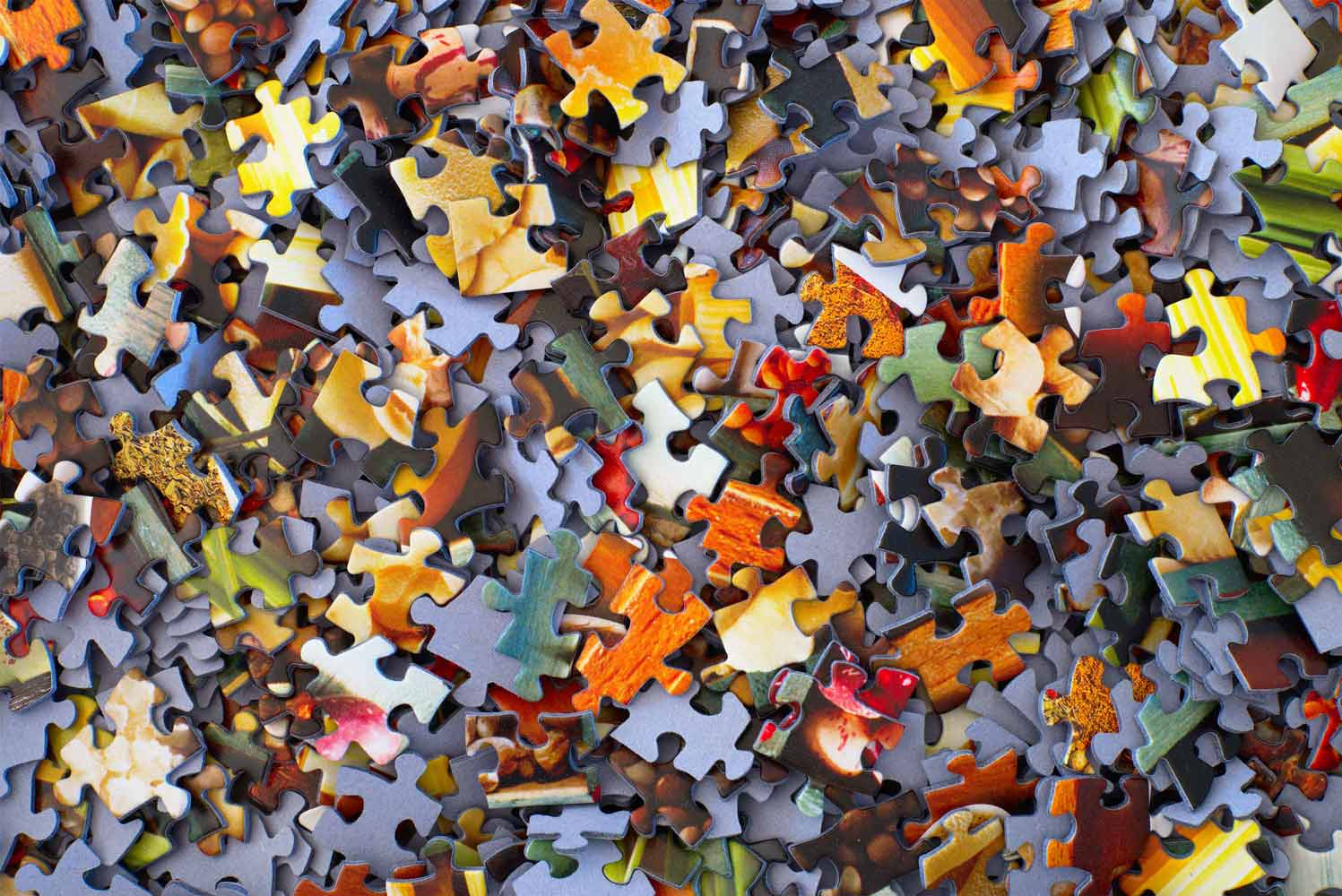 puzzles pieces all over a table
