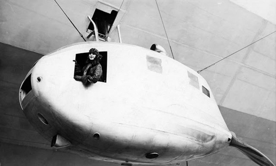black and white photo of lady grace drummond-hay in the engine car of a zeppelin
