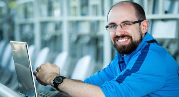 Marc Rochon sitting at his laptop