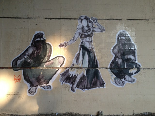 Figure 6. Three female figures on the Tank Wall, by Mozza. Photograph by Bahia Shehab (2013)