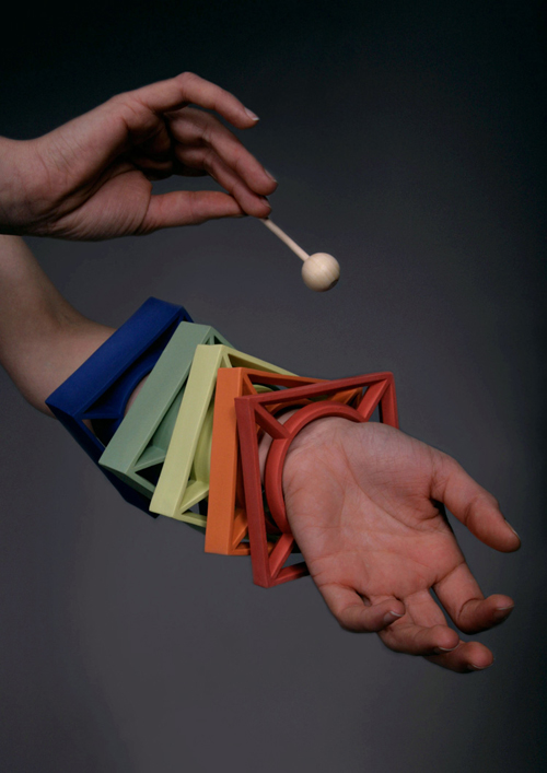 A series of brightly colored bangles, square-shaped, playable by a xylophone mallet.